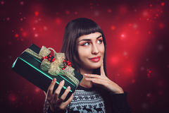 Beautiful woman with christmas package Royalty Free Stock Photography