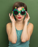 Beautiful woman with Christmas party glasses Royalty Free Stock Images