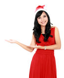 Beautiful woman in christmas santa hat showing copy space Stock Images
