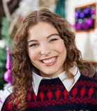 Beautiful Woman In Christmas Store Stock Photography