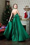 Beautiful woman at the Christmas tree. Royalty Free Stock Photo