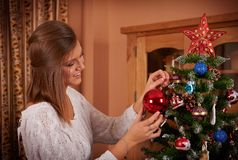 Beautiful woman and christmas tree Royalty Free Stock Image