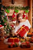 Beautiful woman and christmas tree Stock Photography