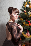 Beautiful woman with Christmas tree Royalty Free Stock Photography