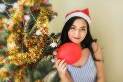 Beautiful Woman at Christmas tree Stock Photo
