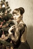Beautiful woman with Christmas tree- vintage card Royalty Free Stock Photos