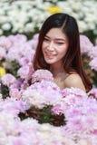 Beautiful woman in chrysanthemum glower garden Stock Photo