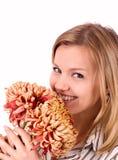 Beautiful woman with chrysanthemums Stock Photos