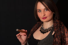 The beautiful woman with a cigar Stock Image