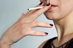 Beautiful woman with a cigarette. Royalty Free Stock Photo