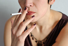 Beautiful woman with a cigarette. Royalty Free Stock Photography