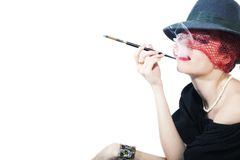 Beautiful woman with cigarette in mouthpiece Stock Image