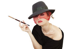 Beautiful woman with cigarette in mouthpiece Royalty Free Stock Photos