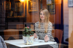 Beautiful woman in a city cafe Royalty Free Stock Images