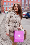 Beautiful woman in city with shopping bag. Royalty Free Stock Images