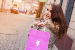Beautiful woman in city with shopping bag. Stock Photo