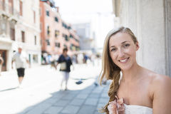 Beautiful woman in a city street Stock Images