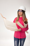 Beautiful woman civil engineer holding blueprints. Young female architect Stock Photo