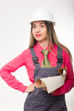 Beautiful woman civil engineer holding blueprints Stock Photography