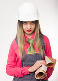 Beautiful woman civil engineer holding blueprints Stock Photo