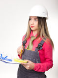 Beautiful woman civil engineer holding blueprints. Young female architect Stock Images