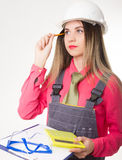 Beautiful woman civil engineer holding blueprints. Young female architect Stock Photos