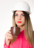 Beautiful woman civil engineer holding blueprints. Young female architect drinking coffee from brown cup Stock Photos