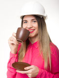 Beautiful woman civil engineer holding blueprints. Young female architect drinking coffee from brown cup Stock Images