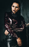 Beautiful woman in claret shirt and black skirt Stock Photo