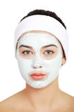 Beautiful woman with clay face mask Stock Image