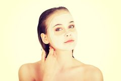 Beautiful woman with clay facial mask.  Royalty Free Stock Photo