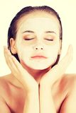 Beautiful woman with clay facial mask Royalty Free Stock Photography