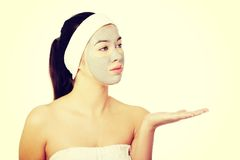 Beautiful woman with clay facial mask Royalty Free Stock Photos