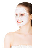 Beautiful woman with clay facial mask Stock Photography