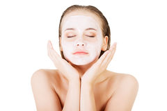 Beautiful woman with clay facial mask Royalty Free Stock Image