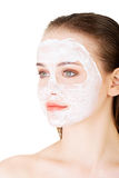 Beautiful woman with clay facial mask Stock Image