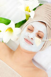 Beautiful woman with a clay mask Royalty Free Stock Photography