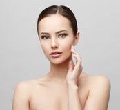 Beautiful Woman with Clean Fresh Skin. Beautiful Face of Young Woman with Clean Fresh Skin close up isolated on white. Beauty Portrait. Beautiful Spa Woman Stock Photo