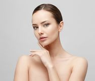Beautiful Woman with Clean Fresh Skin. Beautiful Face of Young Woman with Clean Fresh Skin close up isolated on white. Beauty Portrait. Beautiful Spa Woman Royalty Free Stock Images