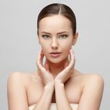 Beautiful Woman with Clean Fresh Skin. Beautiful Face of Young Woman with Clean Fresh Skin close up isolated on white. Beauty Portrait. Beautiful Spa Woman Royalty Free Stock Image