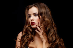Beautiful Woman with Clean Fresh Skin and healthy curly hair Royalty Free Stock Photo