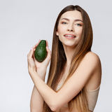 Beautiful Woman with Clean Fresh Skin holding avocado Stock Photography