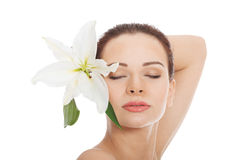 Beautiful woman with clean fresh skin and white flower. Royalty Free Stock Photography