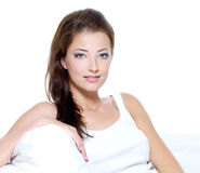 Beautiful woman with clean skin sitting on sofa Stock Photos