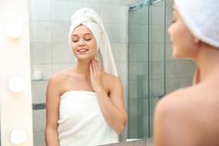 Beautiful woman with clean towels near mirror. In bathroom stock photos