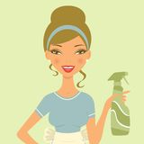 Beautiful woman cleaning with detergent spray Royalty Free Stock Image