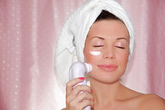 Beautiful woman cleaning face. Heath care, beauty treatment royalty free stock images