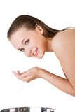 Beautiful woman is cleaning her face Royalty Free Stock Photo