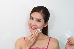 Beautiful woman cleaning her face Stock Photos