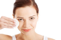 Beautiful woman cleaning her face with cotton pads. Stock Image